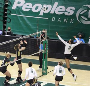 Ohio's Tia Jimerson (15) goes up for a spike in the Bobcats' match against Western Michigan on Friday, March 19, 2021. (Photo: Curtis Feder/WOUB)