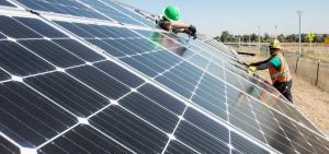 To cut carbon emissions, President Joe Biden announced an initiative to further cut the cost of solar installations, like this one being tested at the National Renewable Energy Laboratory in Colorado.