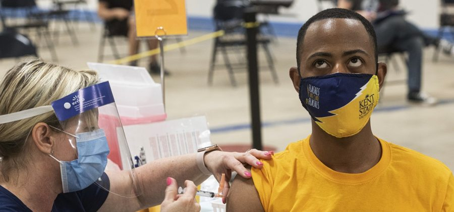 Kent State University student Marz Anderson gets his Johnson & Johnson COVID-19 vaccination from Kent State nurse Beth Krul in Kent, Ohio, Thursday, April 8, 2021.