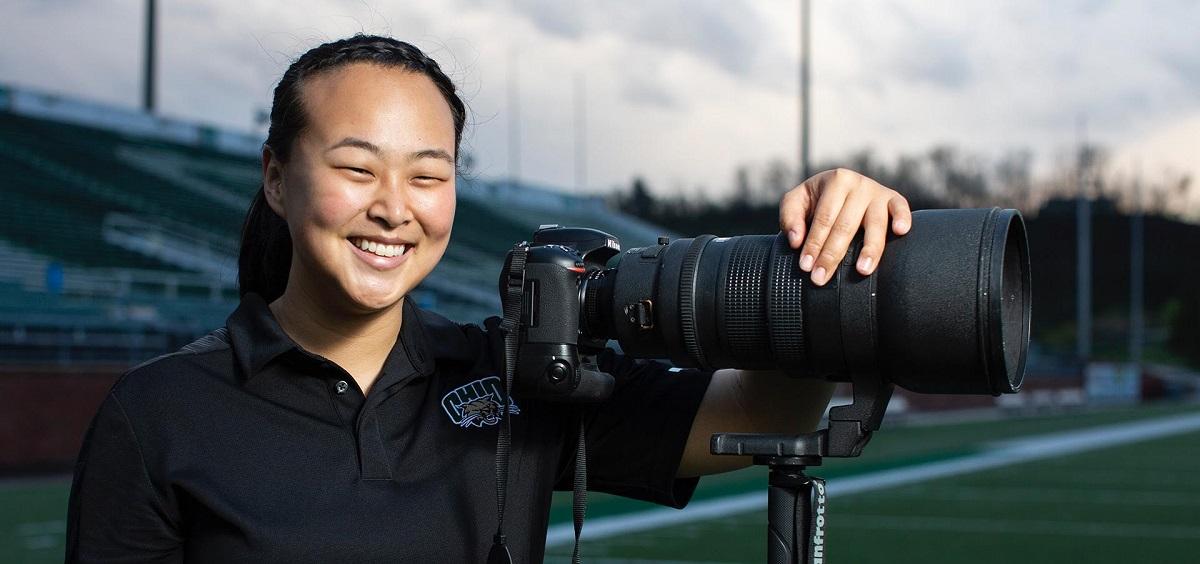 Abigail Dean with camera Headshot