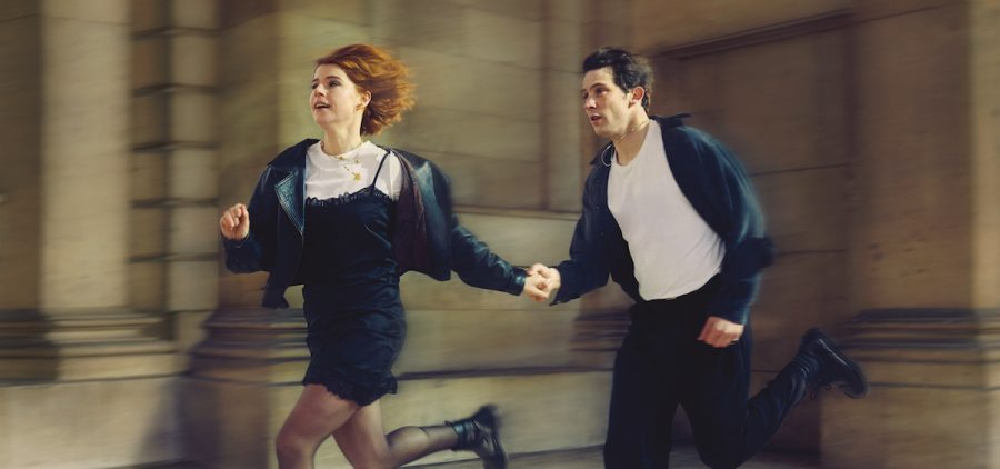 actors playing Romeo and Juliet running down the street