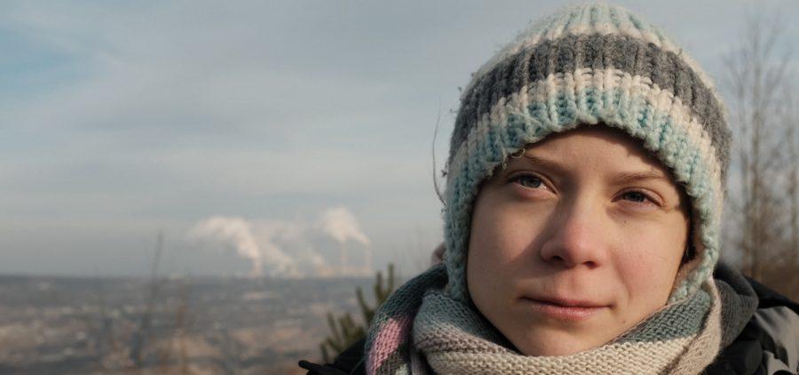 Greta Thunberg beside the Bełchatów coal power station in Poland.