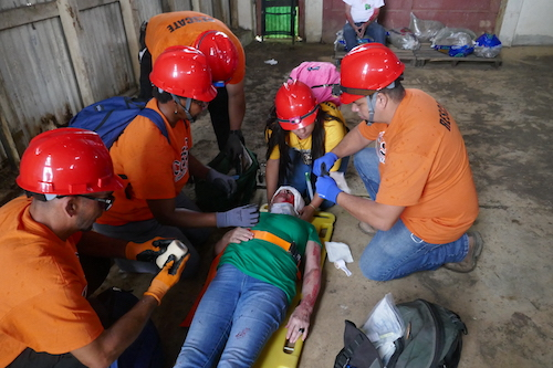Magaly Rodriguez and her team attend to a victim inside the emergency rescue drill. Ciales, Puerto Rico