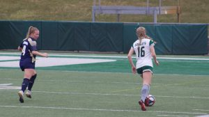 Ohio Soccer's Abby Townsend (16) moves the ball upfield against Akron on Sunday, March 14, 2021 at Peden Stadium. (Photo: Jensen Knecht/WOUB)