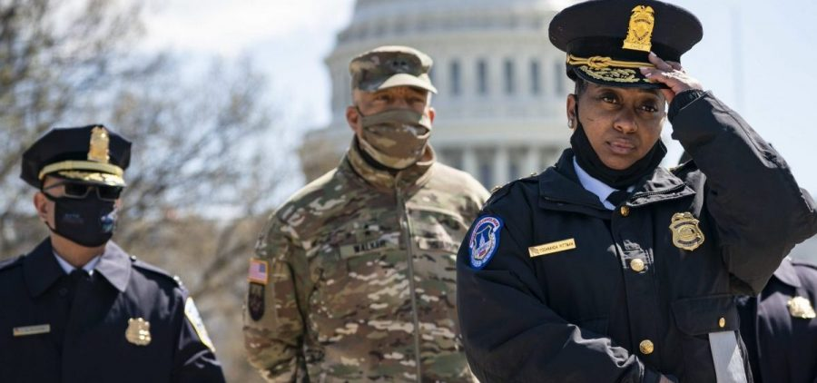 Acting U.S. Capitol Police Chief Yogananda Pittman (right) attends a press briefing about the attack Friday at the U.S. Capitol in Washington, D.C. Pittman announced that one Capitol Police officer died after a man rammed his vehicle into a barrier.