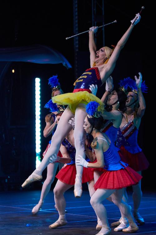 Male ballerina's lift dancer
