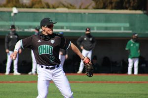 Ohio's Harry Witwer-Dukes warms up at first base during the Bobcats' game against Wisconsin-Milwaukee on March 7, 2021. (PHOTO: Nick Viland/WOUB)