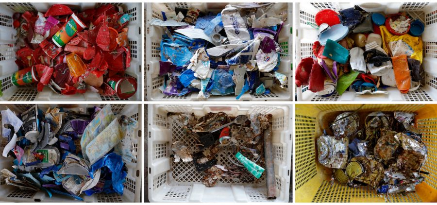 plastics sorted inside recycle baskets at a collecting site
