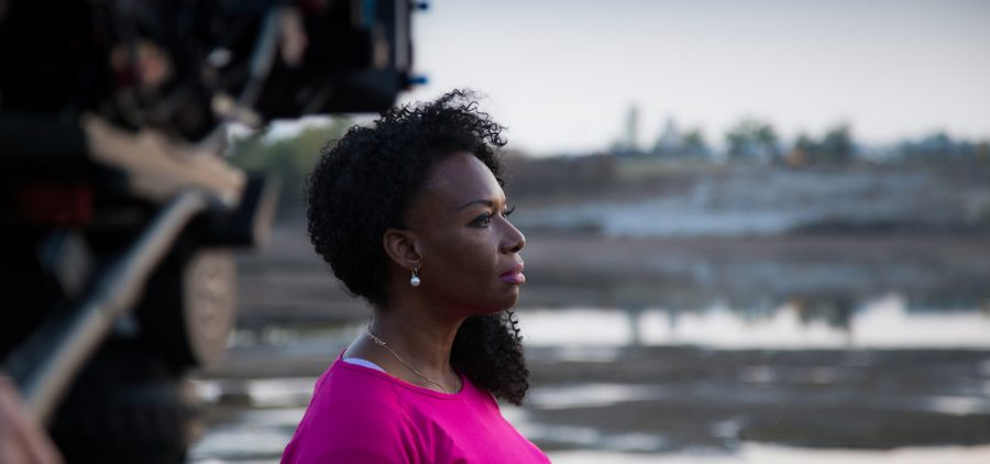 Washington Post reporter DeNeen Brown contemplates a segment of the Arkansas River where forensic archeologists discovered anomalies consistent with possible mass graves. 20 October 2020.