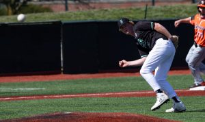 Edward Kutt IV throws to first base as the Ohio baseball team competes against Bowling Green on Monday, March 22, 2021, at Bob Wren Stadium in Athens, OH. OU lost against Bowling Green 11-5. (Chris J. Day/WOUB)