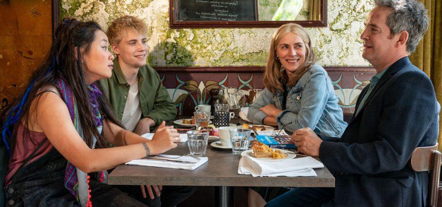 Family of four eating at restaurant
