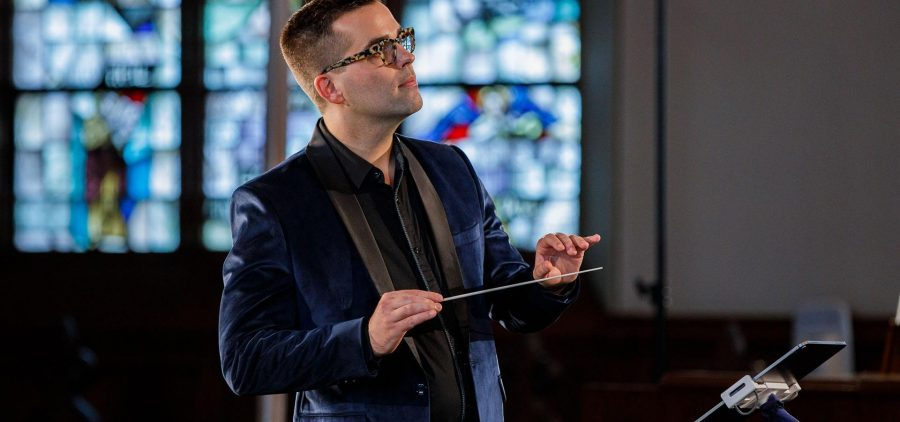 conductor with stained glass in background