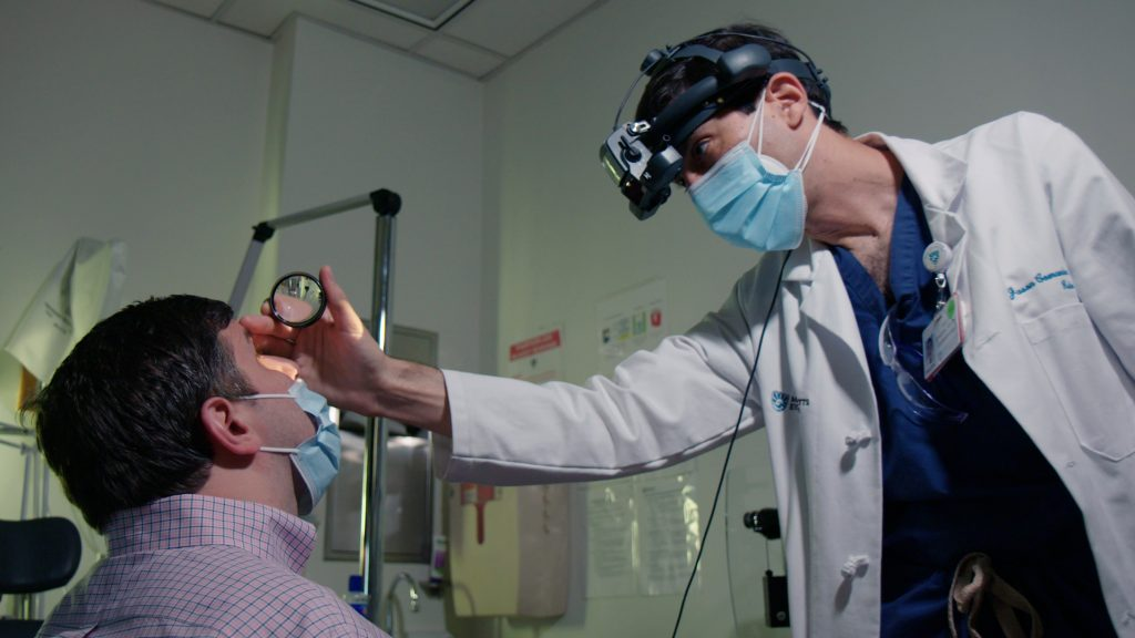Kalberer visits with Dr. Jason Comander at Mass Eye and Ear in Boston. Doctors are comparing the vision of patients before and after the procedure, and between their treated and untreated eyes, to see if the procedure is helping them see better.