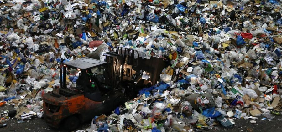 A worker operates a forklift to move household waste at a facility that stores recyclable materials in Seoul, South Korea. In 2019, more than 130 million metric tons of single-use plastics were thrown away, according to a new report.