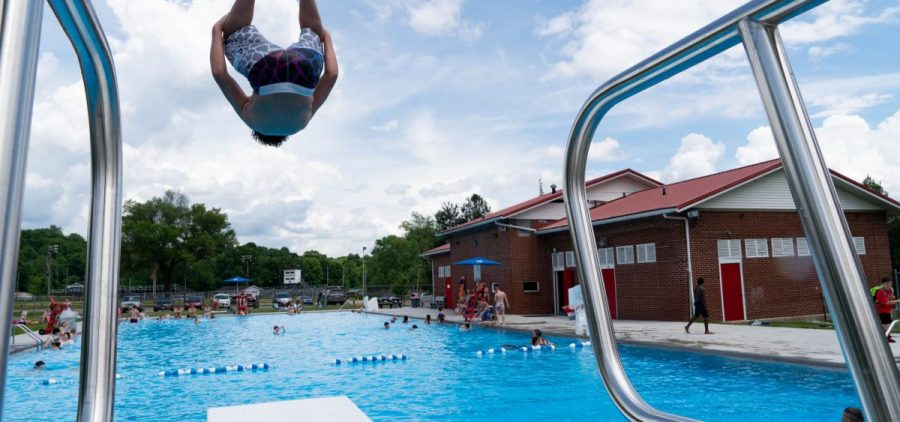 """Cameron Benson performs a double front flip at the Crooksville Municipal Pool during it's grand opening after having been closed for two years, in Crooksville, Ohio, on Tuesday, June 8, 2021. """"There were a lot of sad kids last year,"""" said Gracelyn Frame, a lifeguard at the Crooksville Municipal Pool. """"No one has qualifications to work here. I think [this year] we have maybe 6 or 7 lifeguards where we normally have 14 or more which is why the hours are so different."""