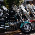 Motorcycles, mostly Honda VaMotorcycles, mostly Honda Valkyries, fill East Union Street, in Athens, Ohio, during a Valkyrie Riders Cruiser Club block party, on Tuesday, June 15, 2021. The Honda Valkyrie was designed by Joe Boyd, and was produced from 1996-2003. The motorcycle features a flat 6 cylinder engine and runs smoothly enough that a nickel can be balanced on it's edge on the engine while the motorcycle is running. [Joseph Scheller | WOUB]lkyries, fill East Union Street, in Athens, Ohio, during a Valkyrie Riders Cruiser Club block party, on Tuesday, June 15, 2021. The Honda Valkyrie was designed by Joe Boyd, and was produced from 1996-2003. The motorcycle features a flat 6 cylinder engine, and runs so smoothly you can balance a nickel on it's edge while the motorcycle is running. [Joseph Scheller | WOUB]