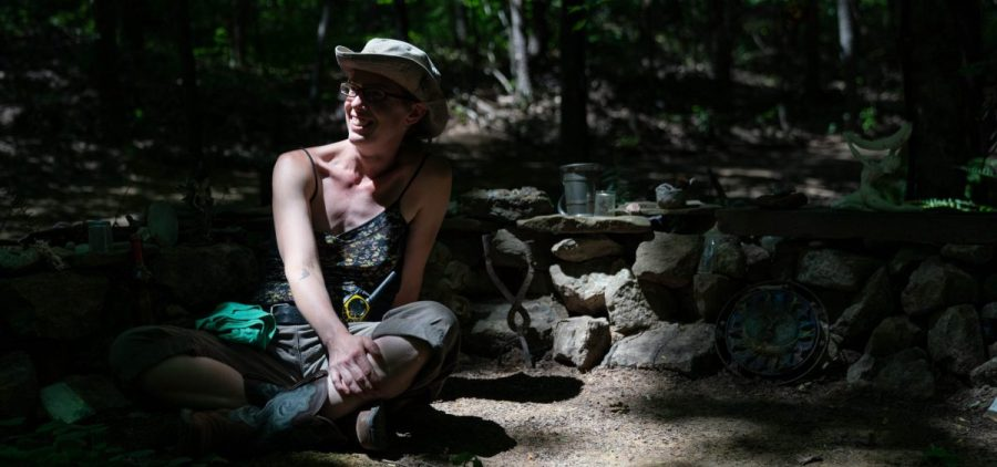 """Jess Fritz laughs in a portrait at the Faerie Shrine, where she was married, at the Wisteria Event Site and Campground during the Summer Solstice 2021 festival, in Pomeroy, Ohio, on Thursday, June 17, 2021. """"This is paradise on earth,"""" said Fritz. """"The more I've learned about it and the biodiversity here, I've realized it's a national treasure that people don't pay attention to."""" [Joseph Scheller 
