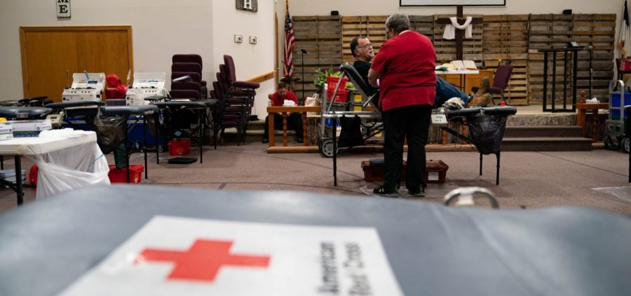 """Ken Yuchasz, left, speaks to a red cross employee while donating blood at a donation event for Brinley Boyd, in New Lexington, Ohio, on Thursday, June 24, 2021. Ken, who has been donating blood since high school, lost a son 5 years ago due to medical complications and said the experience reminded him of the importance of blood donation. """"This is not something that can be artificially created,"""" said Ken. """"This is something that we can do. And if you can, I encourage you to."""" [Joseph Scheller 