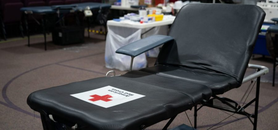 A blood donation chair sits unused