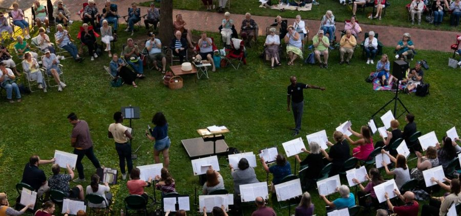 Ohio University students and community members perform in an orchestra in an Under the Elms concert, part of a summer music series organized by the School of Music at the university, in Athens, Ohio, on Wednesday, June 23, 2021. The concerts are free to attend, and the next in the series will be at College Green on June 30, 2021, at 7pm. [Joseph Scheller | WOUB]