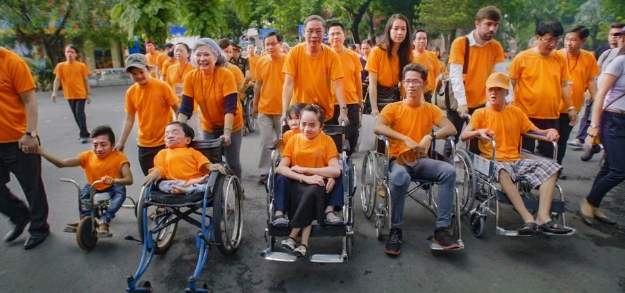A march with Agent Orange victims in wheelchairs