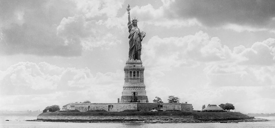 Black and white historical image of the Statue Of Liberty