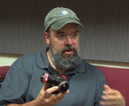 Eric Williams holds a 360-degree camera, used to film virtual reality training scenarios for law enforcement.