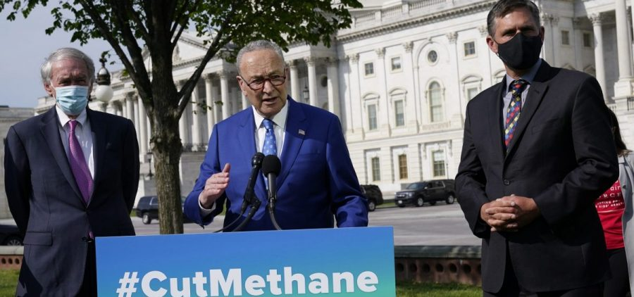 Senate Majority Leader Chuck Schumer, joined by Sens. Ed Markey (left) and Martin Heinrich, discusses legislation in April to reimpose regulations to reduce methane pollution from oil and gas wells.