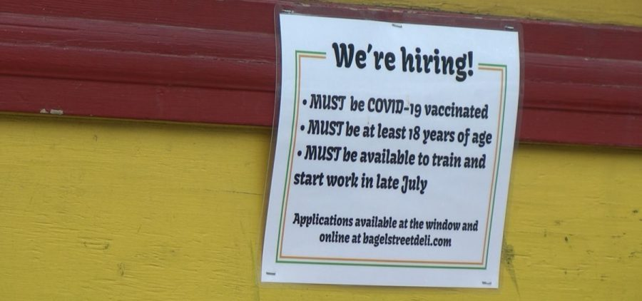 Bagel Street Deli sign with the covid-19 vaccination requirement for employment