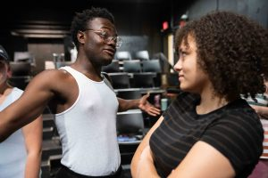 Rhys Carr, left, sings a duet with Sydney Lewis while rehearsing for Ohio Valley Summer Theater's 70th anniversary performance, in Athens, Ohio, on Thursday, July 8, 2021. [Joseph Scheller | WOUB]