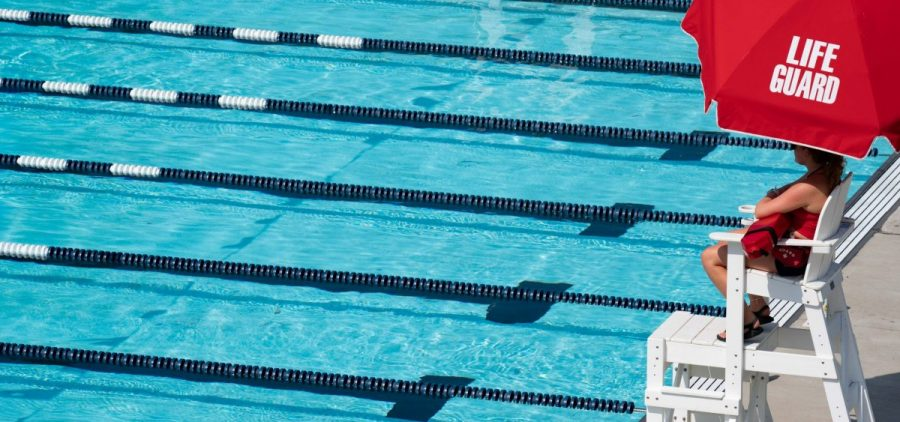 A life guard observes swimmers during lap swim at the Athens Public Pool, in Athens, Ohio, on Monday, July 26, 2021. [Joseph Scheller | WOUB]