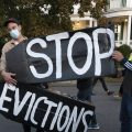 Housing activists erect a sign in Swampscott, Mass. A federal freeze on most evictions is set to expire soon. The moratorium, put in place by the Centers for Disease Control and Prevention in September, was the only tool keeping millions of tenants in their homes.