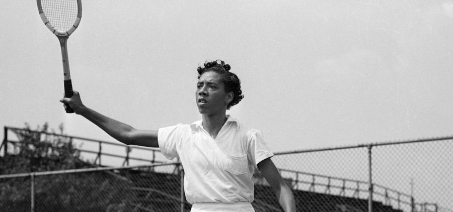 Althea Gibson with tennis racket in air