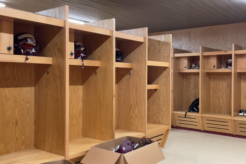 Large empty lockers made of lightly furnished wood