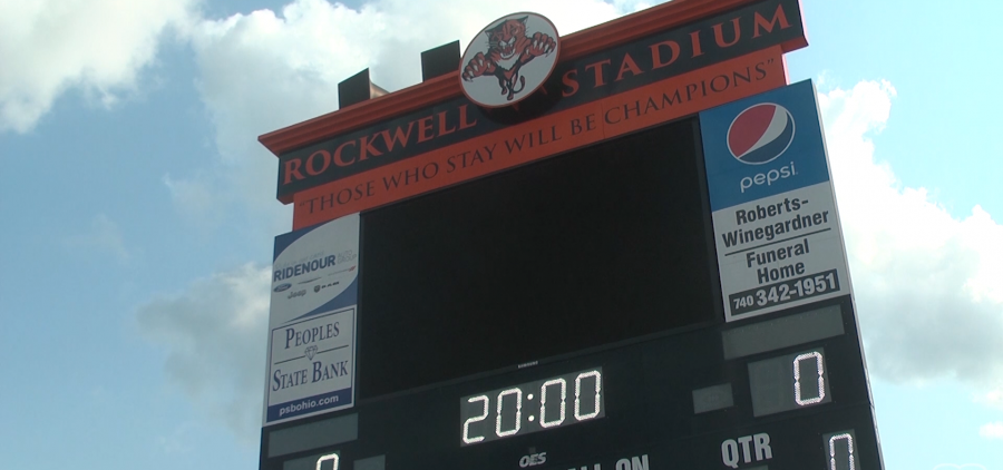 """Scoreboard at Rockwell Stadium, which reads """"Those who stay will be champions"""""""