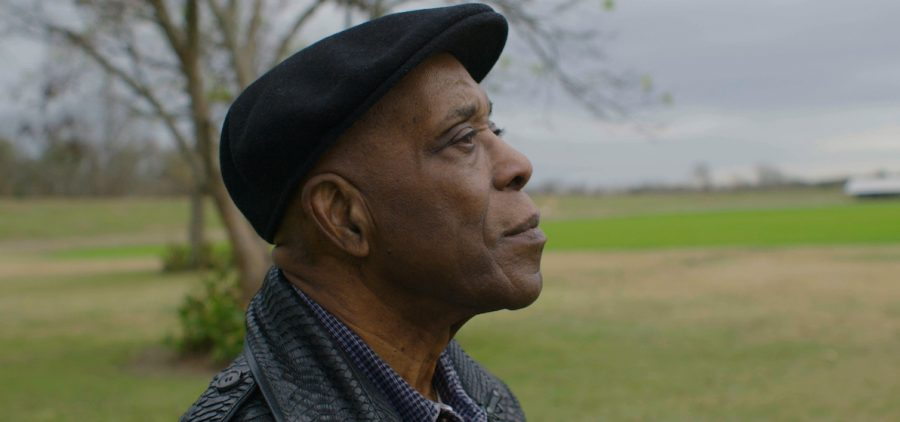 Buddy Guy looking over grassy area