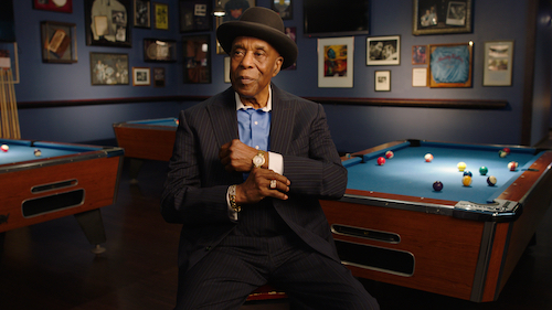 Buddy Guy in front of pool tables