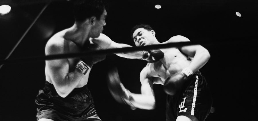 Max Schmeling lands a left to the face of Joe Louis in 1936