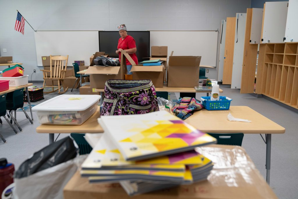 Stephanie More, a kindergarten teacher at East Elementary, unpacks into her new classroom, in Athens, Ohio, on Tuesday, Aug. 10, 2021. [Joseph Scheller | WOUB]