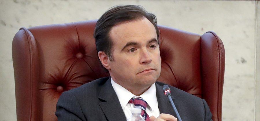 In this March 21, 2018, file photo, Cincinnati Mayor John Cranley listens during a city council meeting in Cincinnati. Cranley has made it official: he's running to be governor of Ohio. With the launch of his campaign, he joins his friend, Dayton Mayor Nan Whaley, in the Democratic field.