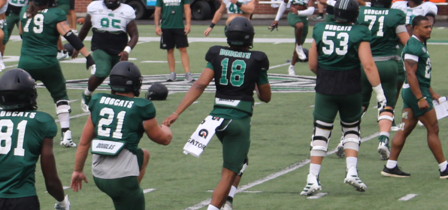 Ohio fifth year senior quarterback Armani Rogers stretches his legs prior to Ohio's first fall scrimmage on Aug. 14, 2021 [Jack Demmler | WOUB]