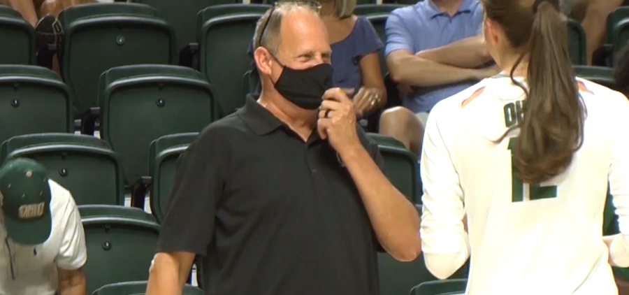 Ohio volleyball head coach Geoff Carlston talks with Caitlin O'Farrell (12) on the sideline in Ohio's exhibition match with Duquesne on August, 21, 2021 at the Convocation Center