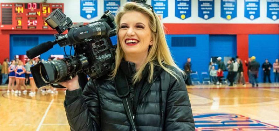 Karli Bell holding camera