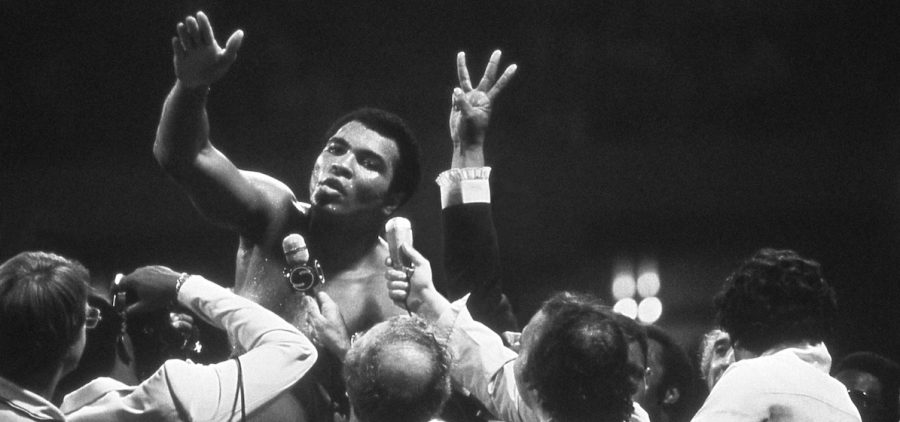 Muhammad Ali talks with the press after winning back the Heavyweight Championship for an unprecedented third time by beating Leon Spinks at the Super Dome in New Orleans, LA. September 15, 1978.