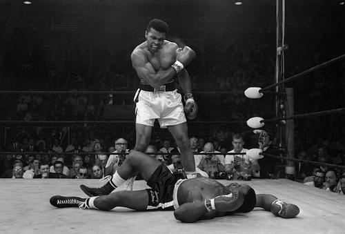 Heavyweight champion Muhammad Ali stands over fallen challenger Sonny Liston