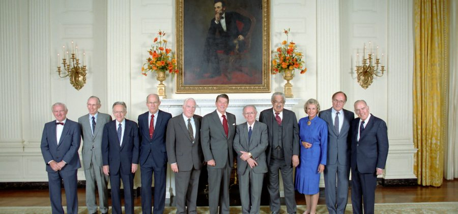 10/1/1985 President Reagan with Chief Justice Warren Burger Justice William Brennan Byron White Justice Thurgood Marshall Justice Harry Blackmun Justice Lewis Powell Justice William Rehnquist Justice John Paul Stevens Justice Sandra Day O'Connor and Justice Potter Stewart during a reception for the United States Supreme Court Justices in the State Dining Room