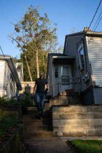 Daniel Palmer, owner and founder of Cafe Doorstep, a coffee delivery service in Athens, Ohio, leaves his home before starting his delivery route on Sunday, Sept. 19, 2021. [Joseph Scheller | WOUB]