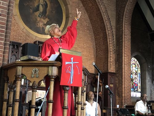Rev. Magora Kennedy leads a worship service in Harlem to commemorate the 50th anniversary of the 1969 Stonewall uprising.
