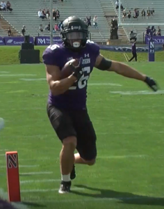 Northwestern runningback Evan Hull runs inside the pylon and into the endzone for his first touchdown of the day against the Bobcats on September 25, 2021.