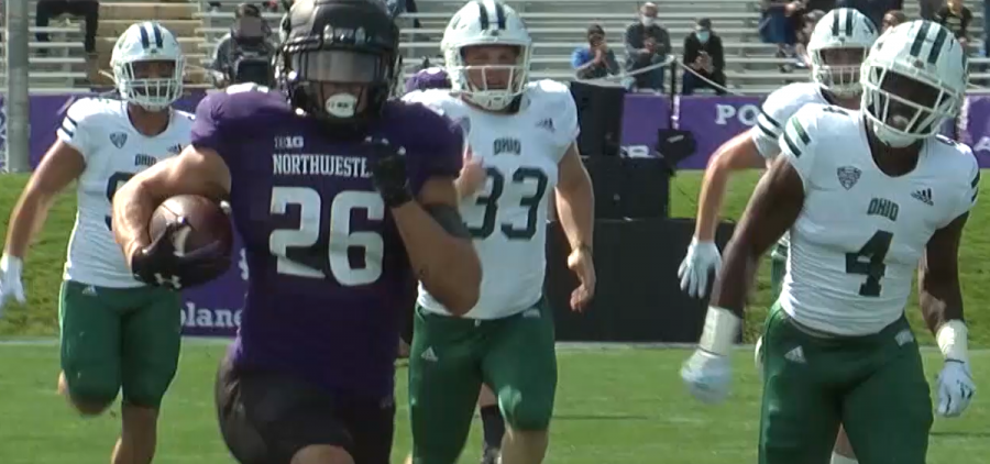 Northwestern runningback Evan Hull runs past the Ohio defense on his way to the end-zone for a 90-yard touchdown run against the Bobcats on September 25, 2021 at Ryan Field in Evanston, Illinois.
